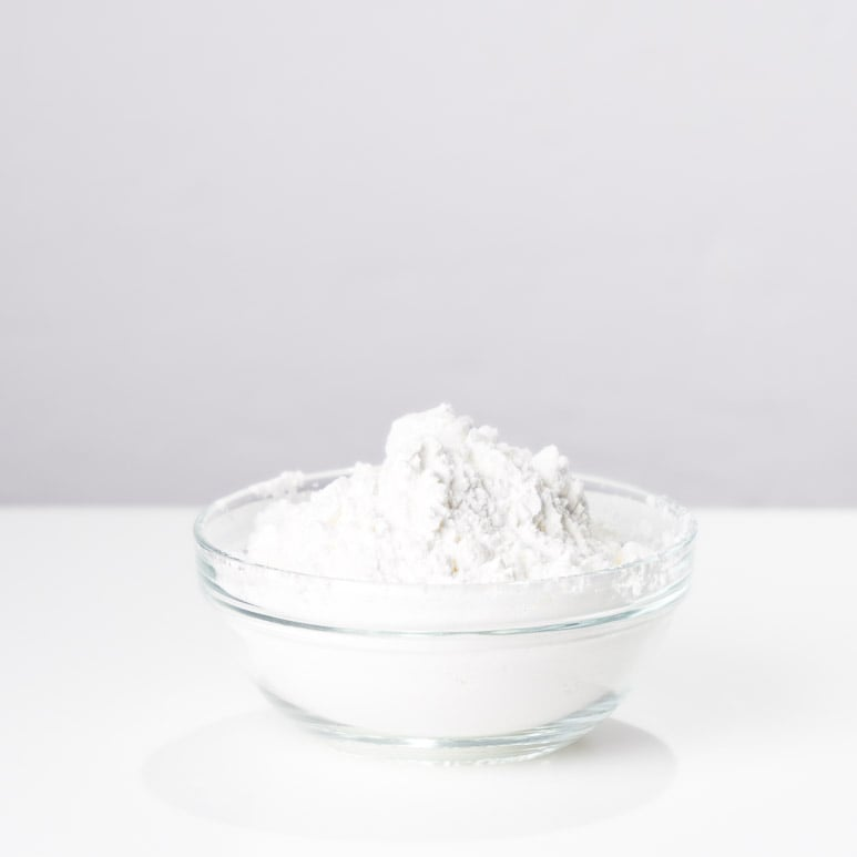 Small bowl of corn starch, this fine white powder is often used as thickener in Chinese recipes.