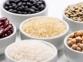 white bowl containing various rice and beans varieties such as jasmin rice and kidney beans.